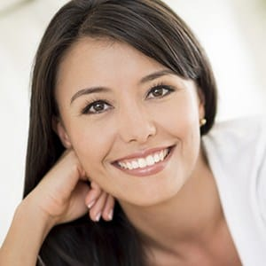 Young woman with gorgeous smile thanks to proper brushing and flossing
