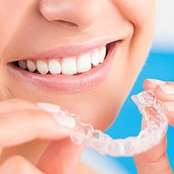 Closeup of patient holding Invisalign tray