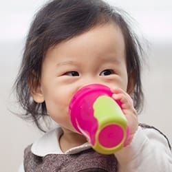 Child drinking from sippy cup